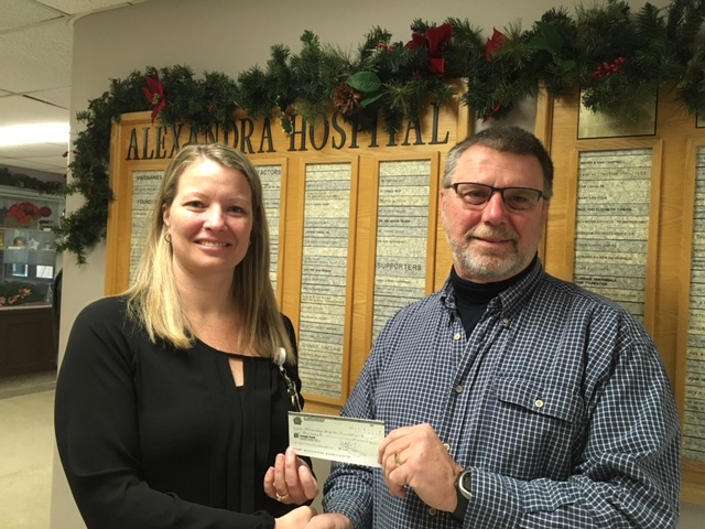 Cheryl Pfaff (left) Chief Quality & Safety Officer & VP, Human Resources accepts a cheque from Ross Crawford.  Ross is presenting the cheque of behalf of the St. John's Lodge #68.